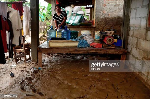 A villager stores fresh water distributed by the local government at her house in a flood affected village in Bekasi West Java on January 4 2020 Tens...