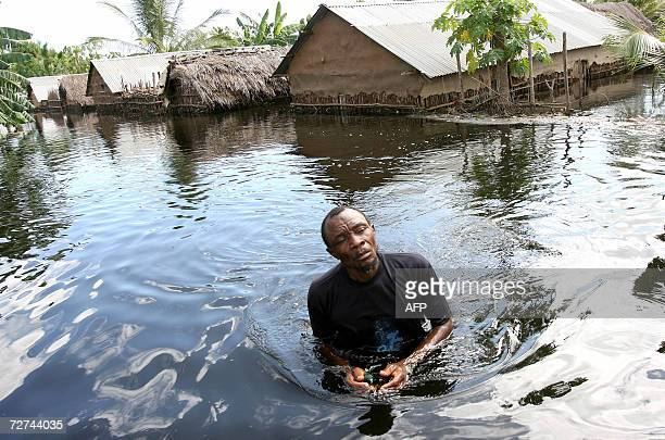 A villager wades through the flood waters that destroyed his home along the Juba river in southern Somalia near the village of Jamame 06 December...