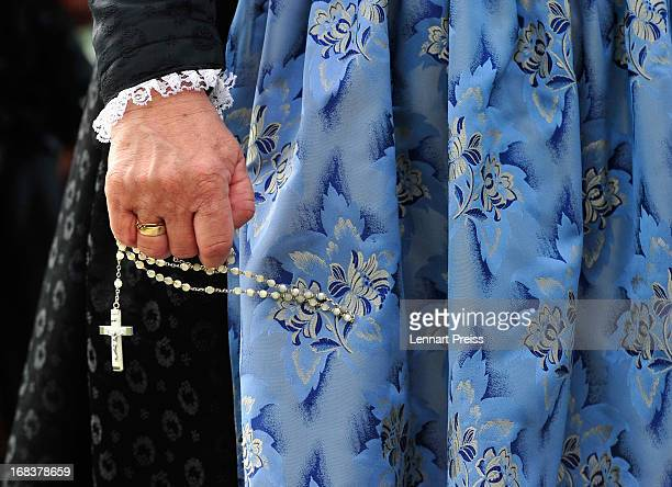 A villager wearing a Bavarian folk costume specific to the Chiemsee region of southern Bavaria holds a chaplet during the annual Ascension Day...