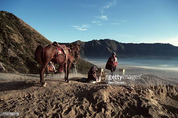 A villager with his horse takes a rest on the sands nearby Mount Bromo the spectacular volcanic peak that is situated high up in Indonesia's Tengger...
