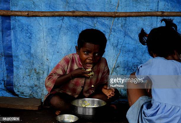 Villagers and village living children look at the Nagada village inside the Nagada Hills in Jajpur district near by 150 km away from the eastern...