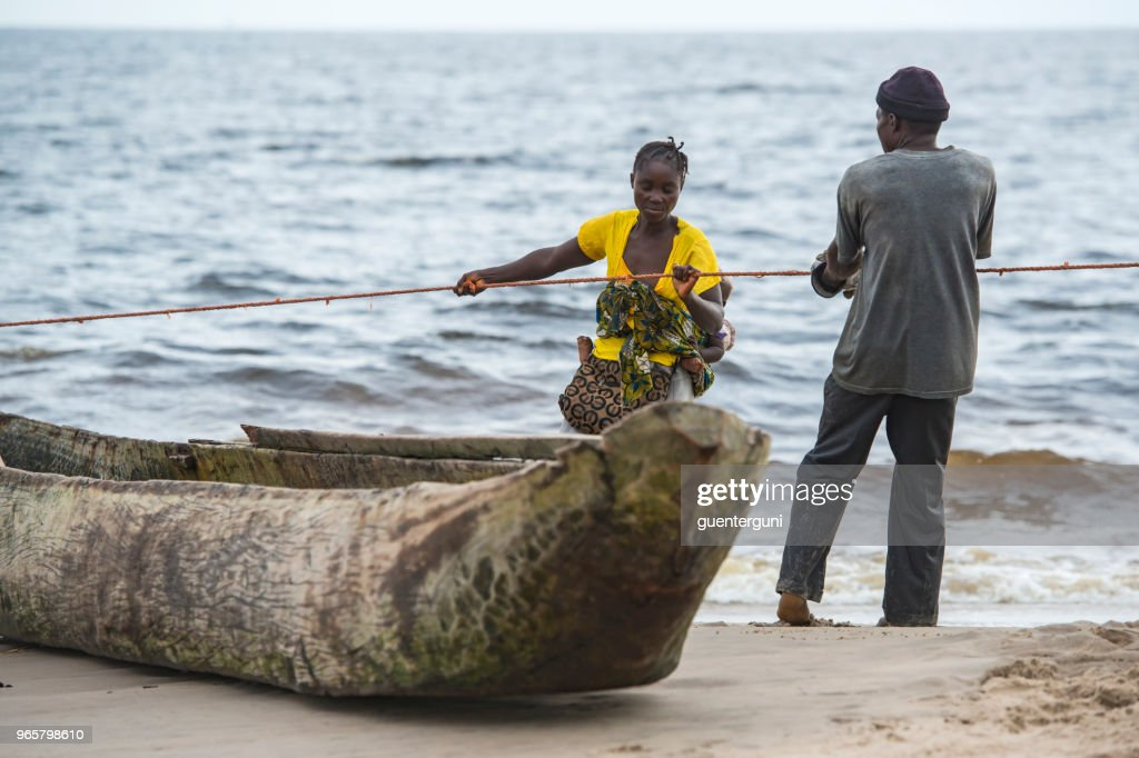 Villagers Are Pulling A Fishing Net Out Of The Ocean Congo
