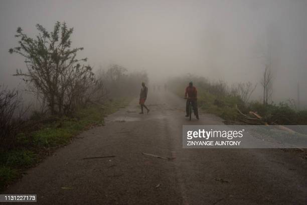 Villagers are seen emerging from a mist on March 17 at Runhowane settlement approximately 30km from Chimanimani Manicaland Province More than 100...