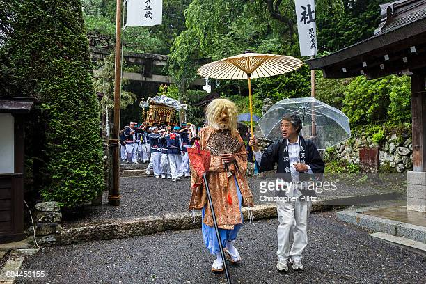 Villagers carry the Mikoshi out of sanctuary