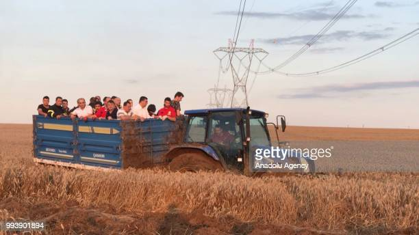 Villagers carry Turkish Disaster and Emergency Management Authority members to the scene with tractor after several bogies of a passenger train...