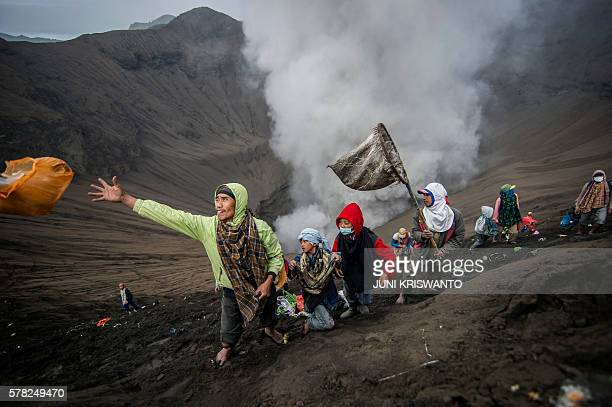 Villagers catch offerings released by Hindu devotees of the Tengger tribe during the Yadnya Kasada festival on the crater of Mount Bromo in...