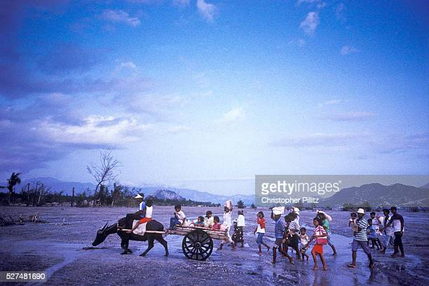 Villagers cross an enlarged river bed after Mount Pinatubo volcanic eruption which caused the displacement of thousands of villagers that surround...