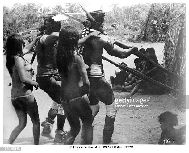 Villagers doing a dance in a scene from the documentary film 'Macabro' 1967