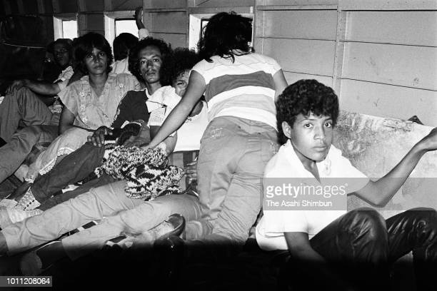 Villagers evacuate by a transport plane after the eruption of the Mt. Nevado del Ruiz on November 17, 1985 in Mariquita, Colombia.