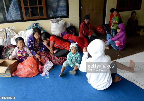 Villagers evacuate to Rendang susbdistrict area during the raised alert levels for the volcano on Mount Agung at Rendang subdistrict in Klungkung...
