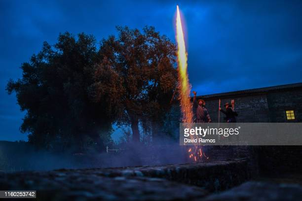Villagers fire off rockets prior to head toward the hills to round wild horses on the eve of the Rapa das Bestas or the 'shearing of the beasts'...