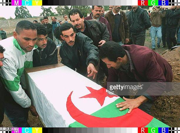 Villagers from Benachour bury victims of the bloody massacre blamed on Islamic fundamentalist militants fighting to overthrow the government in which...