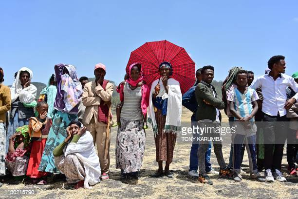 TOPSHOT Villagers from Hama Quntushele village weep as relatives of the victims of the Sunday plane crash visit the crash site of the Ethiopian...