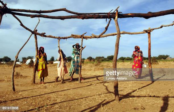 Villagers from Jameisi Jadida and other nearby recently attacked by Chadian Arabs linger by an unfinished structure at dawn in a makeshift camp for...
