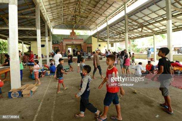 Villagers gather at an evacuation centre in Karangasem on the Indonesian resort island of Bali on September 24 2017 Authorities have raised alert...