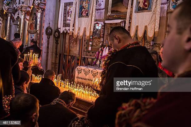 Villagers gather at Holy Trinity Church to celebrate the Orthodox Christmas on January 7 2015 in Iltsi Ukraine While many of the traditions are...