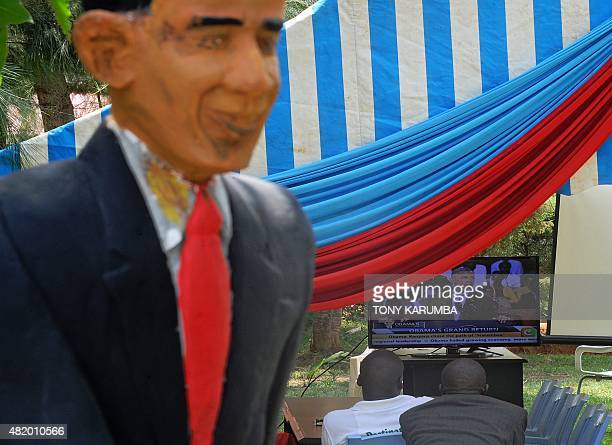 Villagers gather to watch a televised live broadcast of visiting US President Barack Obama at the Barack Obama Primary School in Kogelo in Siaya...
