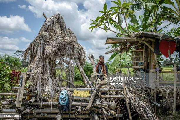 Villagers have a rest in a hut on a paddy field at the village near Ubud Ubud District Bali Indonesia in November 2018