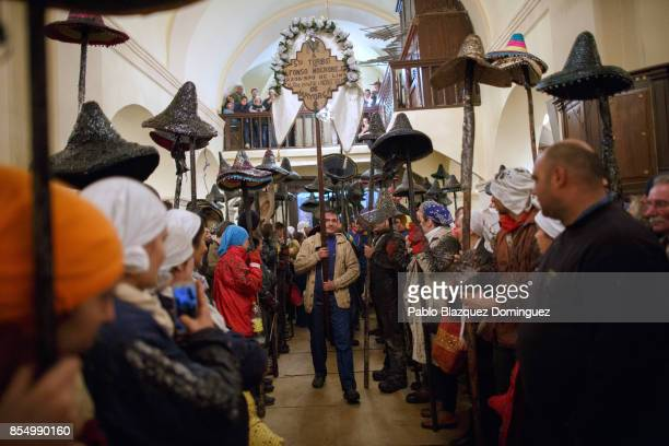 Villagers hold poles with their hats as El Vitor Civic procession arrives to the church on September 27 2017 in Mayorga Valladolid province Spain...