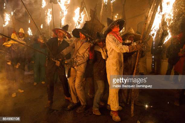 Villagers hold torches made of wine skins during El Vitor Civic procession on September 27 2017 in Mayorga Valladolid province Spain Every 27 of...