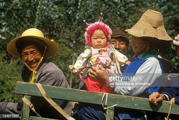 Villagers in horse drawn cart on way to town in Dali Yunnan Province People's Republic of China