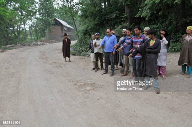 Villagers in Utligam point towards the spot where Farooq Dar was tied up on the Army jeep in Utligam village in Budgam district on May 24 2017 some...
