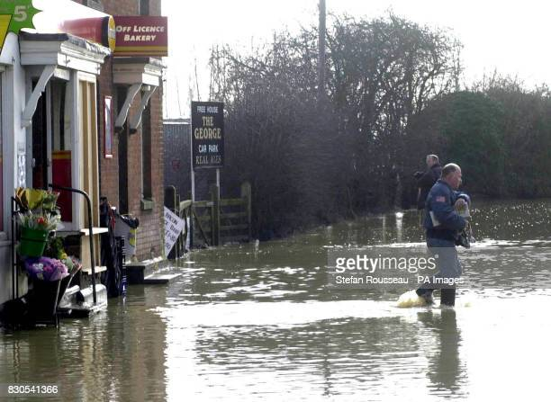 Villagers in Yalding Kent wade through flood water to the local shop Families in the village which saw the worst of the flooding at the end of last...