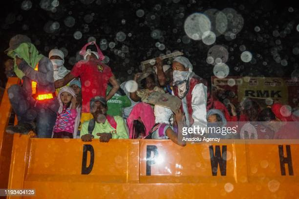 Villagers loads to truck as they evacuate during the Taal volcano eruption in Batangas Philippines on January 13 2020 Authorities in the Philippines...