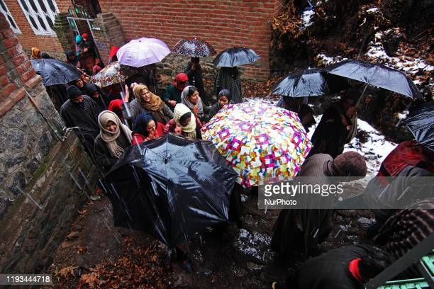 Villagers move towards the graveyard during the funeral ceremony of top rebel commander Umer Fayaz alias Hammad Khan in Tral area of south Kashmir on...