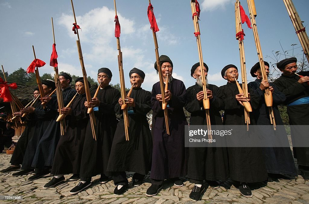 Villagers of Miao ethnic origin blow Lusheng, a free reed mouth organ with five or six pipes, at Langdeshang Village on October 21, 2006 in Leishan County of Qiandongnan Miao and Dong Autonomous Prefecture, Guizhou Province, China. With a population of 8,940,116, the Miao people is one of the largest ethnic minorities in southwest China. Qiandongnan Prefecture is a multi-ethnic region where over 20 ethnic minority groups reside. Miao and Dong minorities make up over 70 percent of its population.