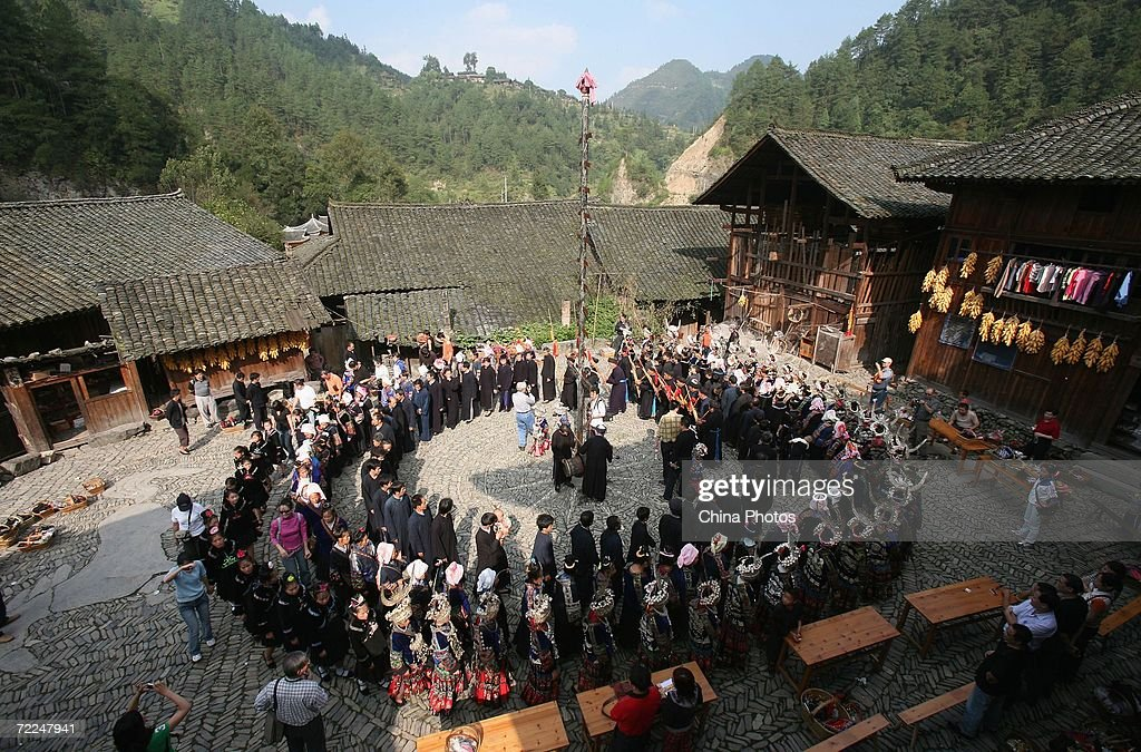 Villagers of Miao ethnic origin dance with tourists at Langdeshang Village on October 21, 2006 in Leishan County of Qiandongnan Miao and Dong Autonomous Prefecture, Guizhou Province, China. With a population of 8,940,116, the Miao people is one of the largest ethnic minorities in southwest China. Qiandongnan Prefecture is a multi-ethnic region where over 20 ethnic minority groups reside. Miao and Dong minorities make up over 70 percent of its population.