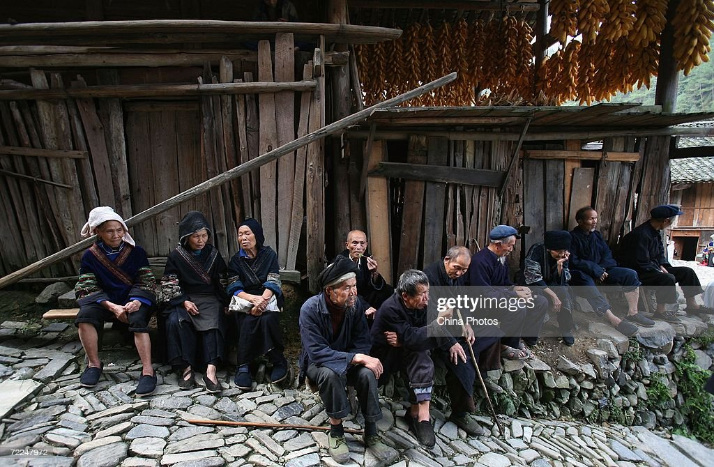 Villagers of Miao ethnic origin wait to watch a performance at Langdeshang Village on October 21, 2006 in Leishan County of Qiandongnan Miao and Dong Autonomous Prefecture, Guizhou Province, China. With a population of 8,940,116, the Miao people is one of the largest ethnic minorities in southwest China. Qiandongnan Prefecture is a multi-ethnic region where over 20 ethnic minority groups reside. Miao and Dong minorities make up over 70 percent of its population.