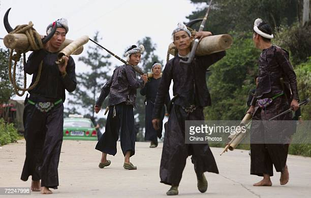 Villagers of Miao ethnic origin walk on a road of Basha Village on October 20 2006 in Congjiang County of Qiandongnan Miao and Dong Autonomous...