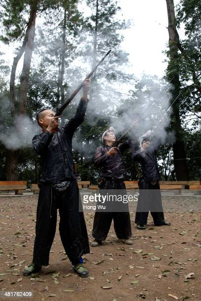 Villagers of Miao ethnic use their fowling pieces to fire as a welcoming ceremony to visitors at Basha Village on March 15 2014 in Congjiang County...