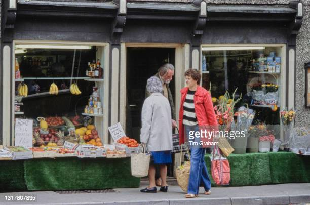 Villagers outside a greengrocer's shop in the village of Tetbury, Gloucestershire, England, 14th July 1986. Tetbury is the neighbouring town of...