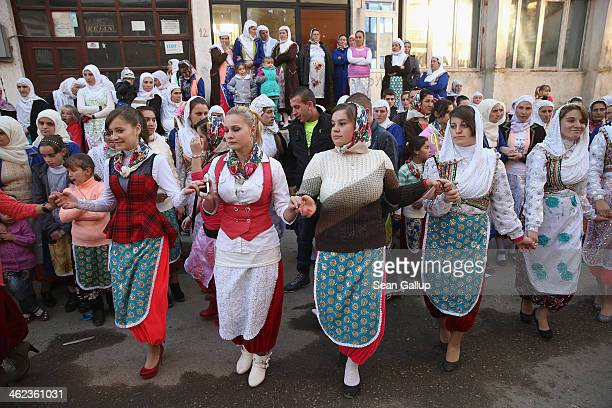 Villagers participate in a group dance on the first day of twoday wedding celebrations for bride Fatme Inus and groom Mustafa Sirakov on January 11...
