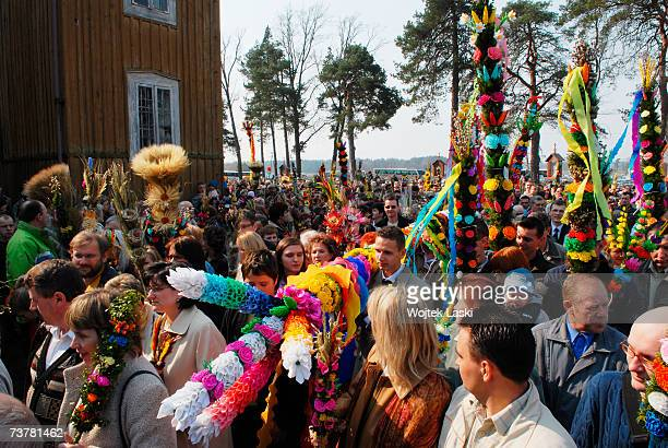 Villagers participate in a Palm Sunday procession between old and new village churches on April 1 2007 in Lyse Poland The procession followed the...
