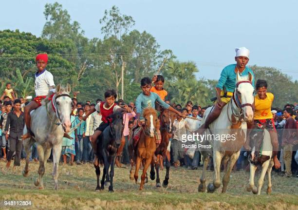 Villagers participate in rural horse race in a paddy field during annual Baisakhi fair