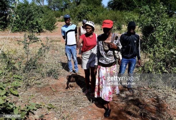 Villagers pass by the scene where a 54 yearoldman Merafhe Cappie Shamukuni was killed by an elephant on his way to work in the morning on April 26 in...