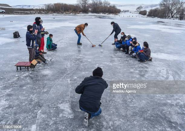 Villagers play curling in their own way on the frozen Kars Stream located in Susuz district of Turkey's Kars province on January 07, 2021.