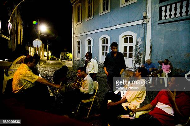 Villagers play music in the streets outside the bar Maria Amelia in the village of San Filipe San Felipe is a lovely little township on Fogo Island...