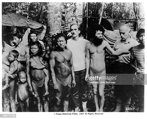 Villagers pose together for a picture in a scene from the documentary film 'Macabro' 1967