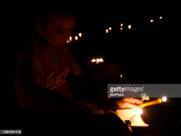 Villagers pray before floating a quotKratongquot on a pond during the Loy Kratong festival in Nakhonsawan province north of Bangkok November 22 2018...