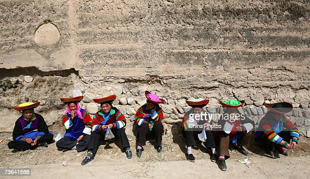 Villagers pray during a ceremony to worship the Erlang God at the Dazhuang Village on March 20 2007 in Huzhu County of Qinghai Province China The...