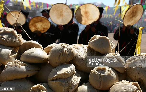 Villagers pray in front of offerings of steamed buns during a ceremony to worship the Erlang God at the Dazhuang Village on March 20 2007 in Huzhu...