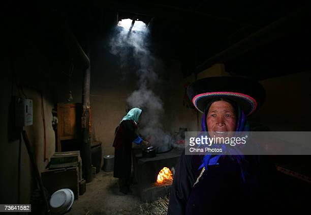 Villagers prepare for a feast during a ceremony to worship the Erlang God at the Dazhuang Village on March 20 2007 in Huzhu County of Qinghai...