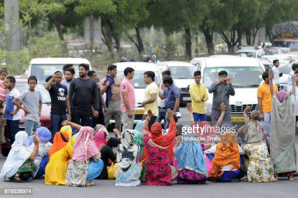 People protest against the dumping ground of sector 123 on June 20 2018 in Noida India