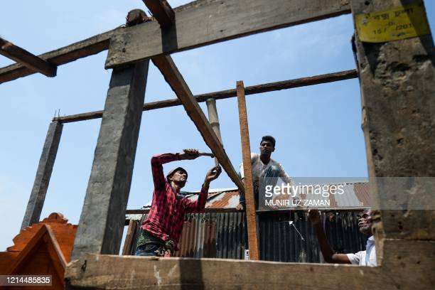 Villagers repair their house damaged by cyclone Amphan in Satkhira on May 22 2020 Bangladesh began a massive cleanup on May 21 after the fiercest...