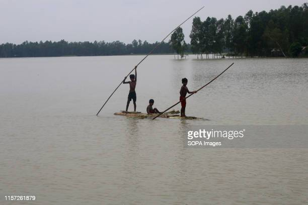 Villagers resorted to travelling on makeshift rafts following heavy monsoon rains at a flood affected area in Tangail Over million people have been...