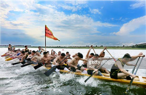 Villagers row dragon boats in a competition to welcome Dragon Boat Festival on June 6 2019 in Shangrao Jiangxi Province of China People race dragon...